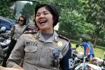 Smile for the Polwan BM, Jakarta's Harley mounted female biker cops