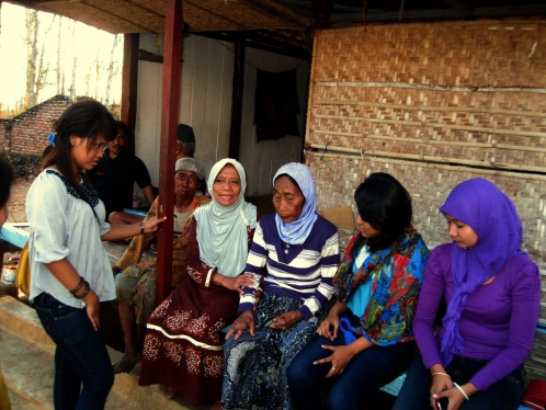 Big, little, and medium-age Madura girls chatting in the village